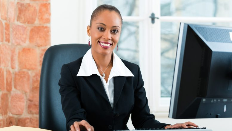 Female paralegal working on a computer