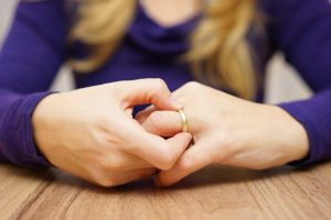 Woman taking off wedding ring