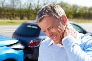 Man Suffering From Whiplash After Car Collision