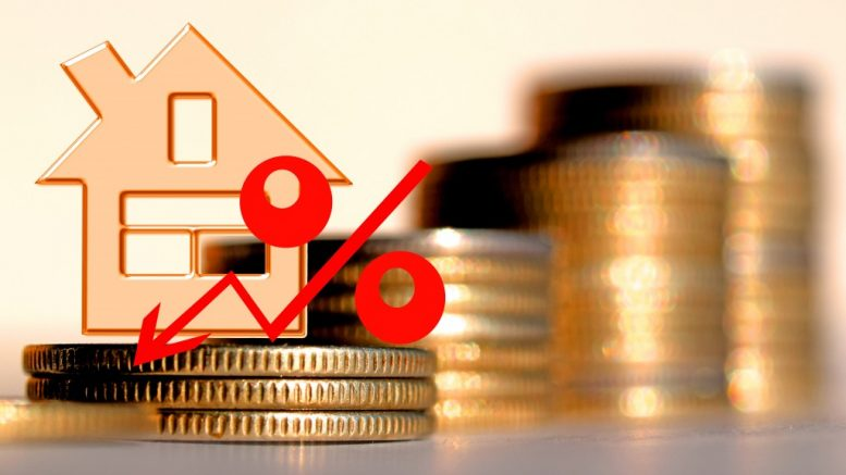 red percent on a background of money & house - the concept of changing prices in the market