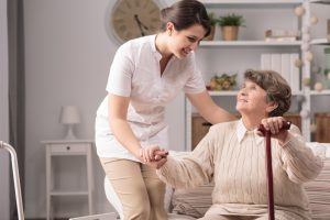 A nurse helping a senior woman