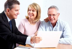 Senior couple consulting with lawyer
