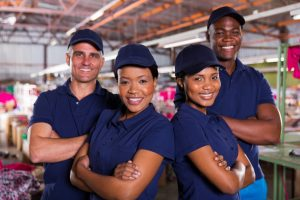 happy textile factory co-workers with arms crossed