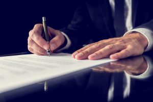 a lawyer signing a legal document