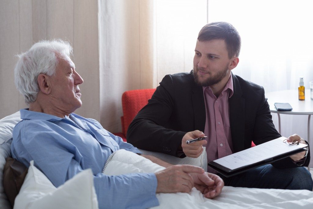 lawyer taking the will of an elderly man