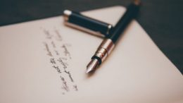 black and silver fountain pen on top of a written will