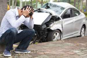 Man at a car accident scene