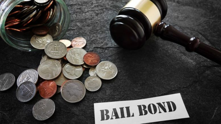 bail bond with gavel and money