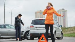 man and woman in a road accident