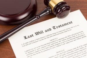 Last will and testament with a wooden gavel