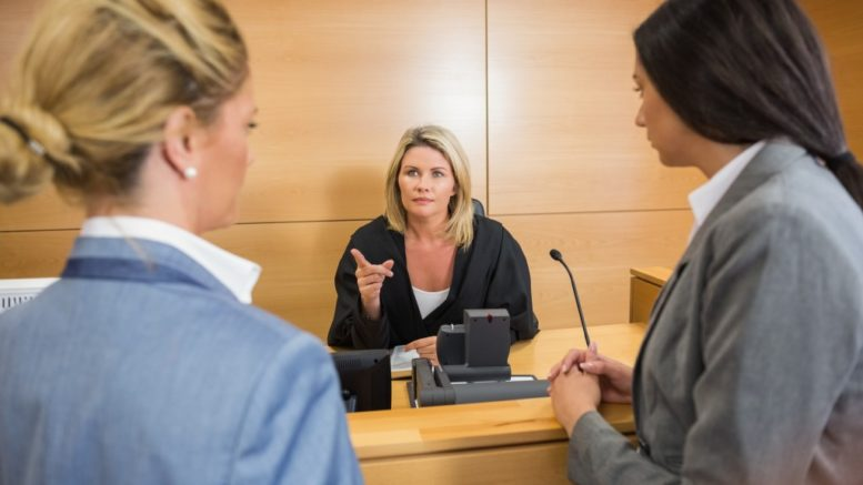 lawyers speaking with a judge